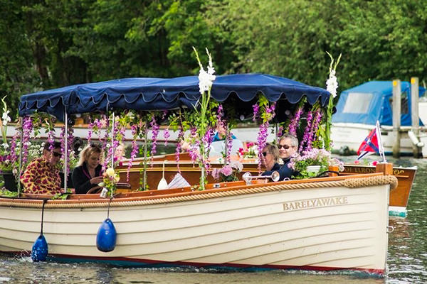 """""""Barely Awake"""" participating in the floral flotilla"""