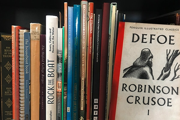 "One of my bookshelves and Daniel Defoe's ""Robinson Crusoe"" - A real classic"