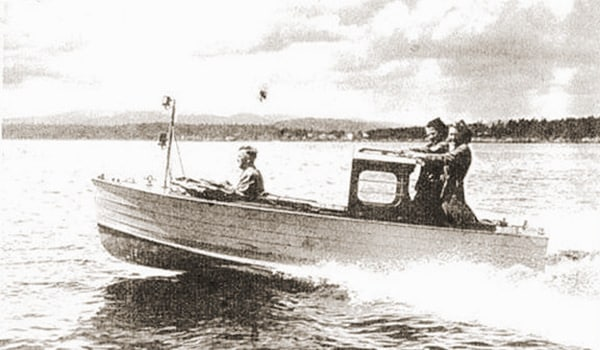 Period photo of one of the fast wooden motor dinghies.