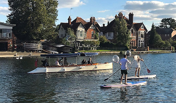 Paddling bride and groom at their Marlow wedding earlier this month.