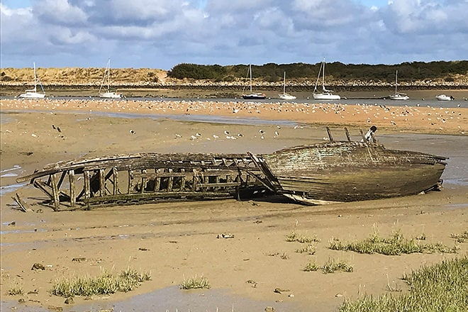 Boat remains on the beach in Normandie, France.