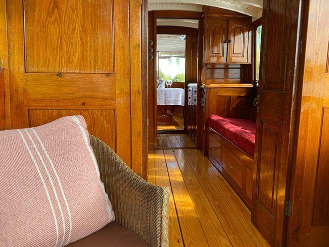 'Tarbes II's' beautiful varnished mahogany interior