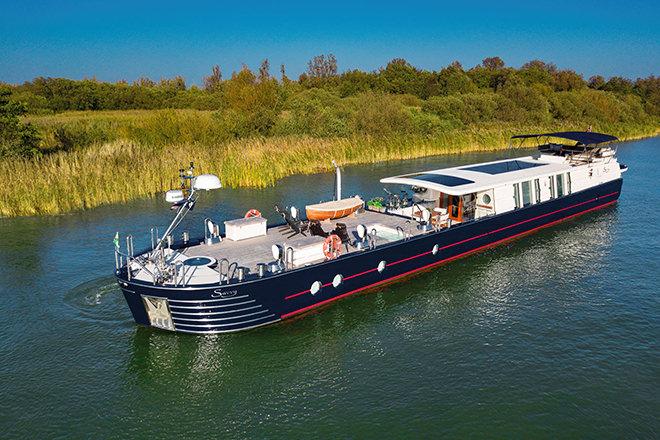'Savvy' - an almost 30m long, award winning, yacht barge - for sale through HSC.