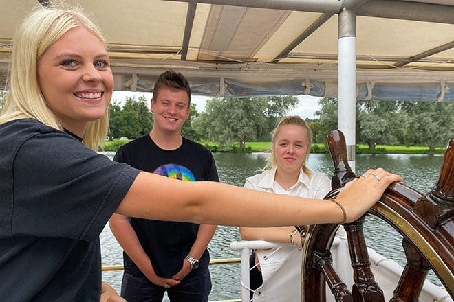 PureBoating staff crewing at the Henley Festival (en route to collect our guests from Hurley) - Olivia at the helm and James & Sasha on the port side.