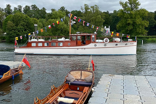 'St. Joan' - looking shipshape and beautifully decorated, with her owner Hannah at the helm.